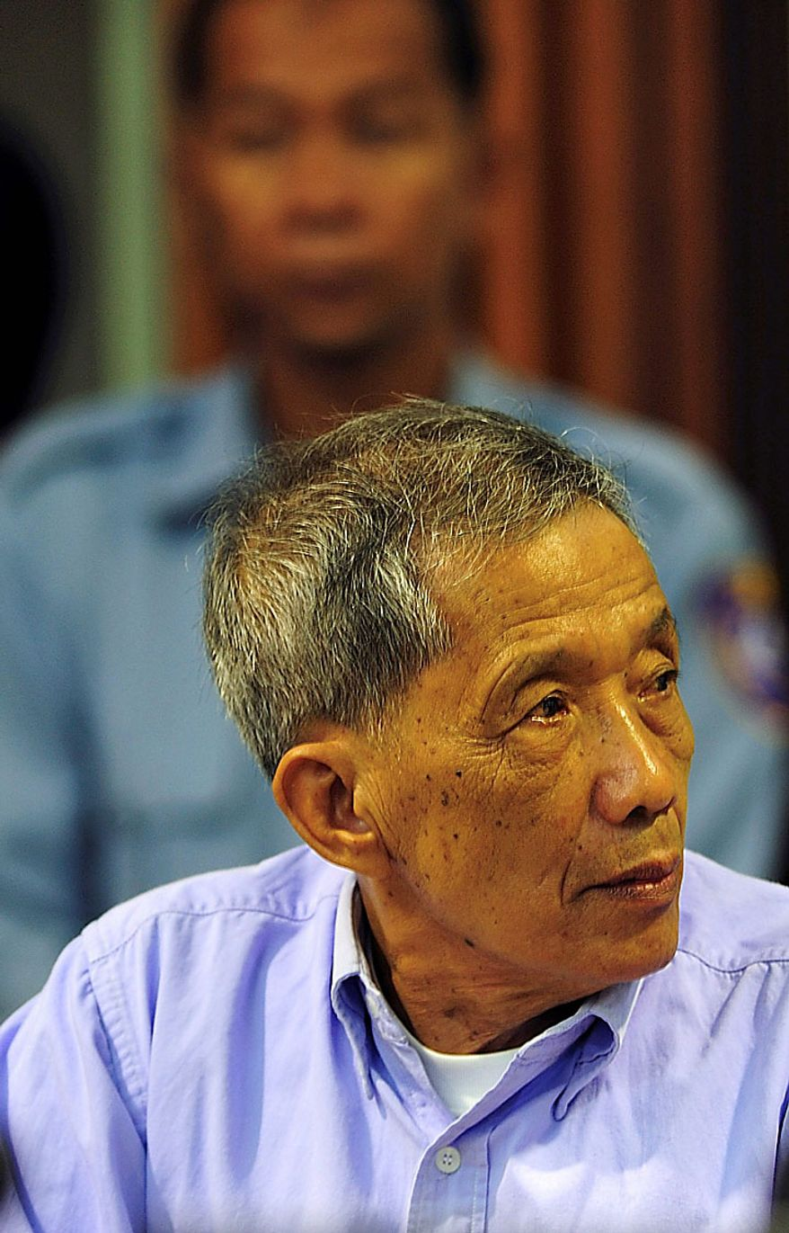 """In this photo released by the Extraordinary Chambers in the Courts of Cambodia, Kaing Guek Eav, also known as Duch, who ran the notorious Toul Sleng, a top secret detention center for the worst """"enemies"""" of the state, looks on during his sentencing at the U.N.-backed war crimes tribunal in Phnom Penh, Cambodia, Monday, July 26, 2010. The U.N.-backed tribunal has found the former Khmer Rouge chief jailer guilty of war crimes and crimes against humanity and ordered him to serve 19 years in prison. (AP Photo/ Extraordinary Chambers in the Courts of Cambodia)"""