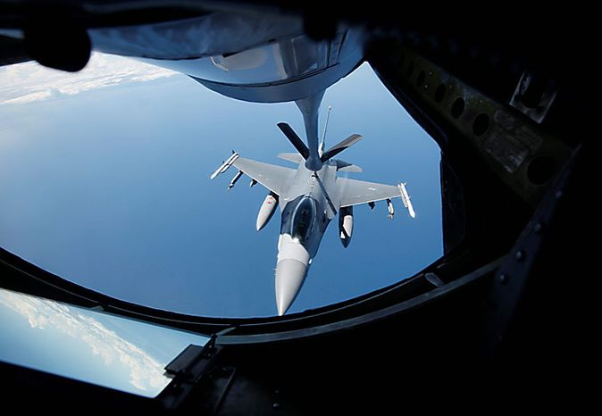 A KC-135 Stratotanker from the 909 Air Fueling Squadron of the 18th Wing of the U.S. Air Force, based in Japan's Kadena, conducts aerial refueling to a F-16 Fighting Falcon from the U.S. Seventh Air Force's 8th Fighter Wing, based in South Korea's Gunsan, during a joint military drills between South Korea and the U.S. over the East Sea, east of Seoul, South Korea, Monday, July 26, 2010. (AP Photo/Lee Jae-won, Pool)