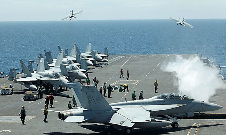 U.S. fighters take off from the flight deck of the Nimitz-class USS George Washington for joint military exercises between the U.S. and South Korea in South Korea's East Sea on Monday, July 26, 2010. U.S. and South Korean warships and helicopters practiced anti-submarine maneuvers off the Korean Peninsula Monday that officers said they hope would serve as a warning to Pyongyang that aggression in the region would not be tolerated. (AP Photo/ Lee Jin-man, Pool)