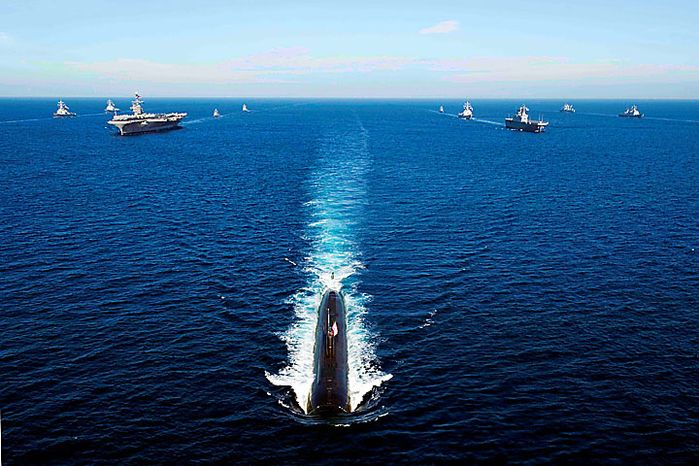 In this photo provided by the Navy Visual News Service, U.S. Navy and Republic of Korea ships transit the East Sea Monday, July 26, 2010, in a 13-ship formation led by the Los Angeles-class attack submarine USS Tuscon (SSN 770). The Republic of Korea and the United States are conducting joint exercises in the seas east of the Korean Peninsula from July 25-28, 2010. (AP Photo/Navy Visual News Service, PO 3rd Class Adam K. Thomas)