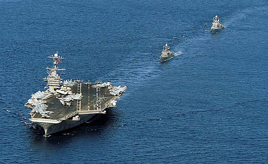 ** FILE ** The nuclear-powered aircraft carrier USS George Washington leads South Korean warships during joint military drills in the East Sea/Sea of Japan on Monday, July 26, 2010. (AP Photo/Yonhap, Lee Jung-joon)