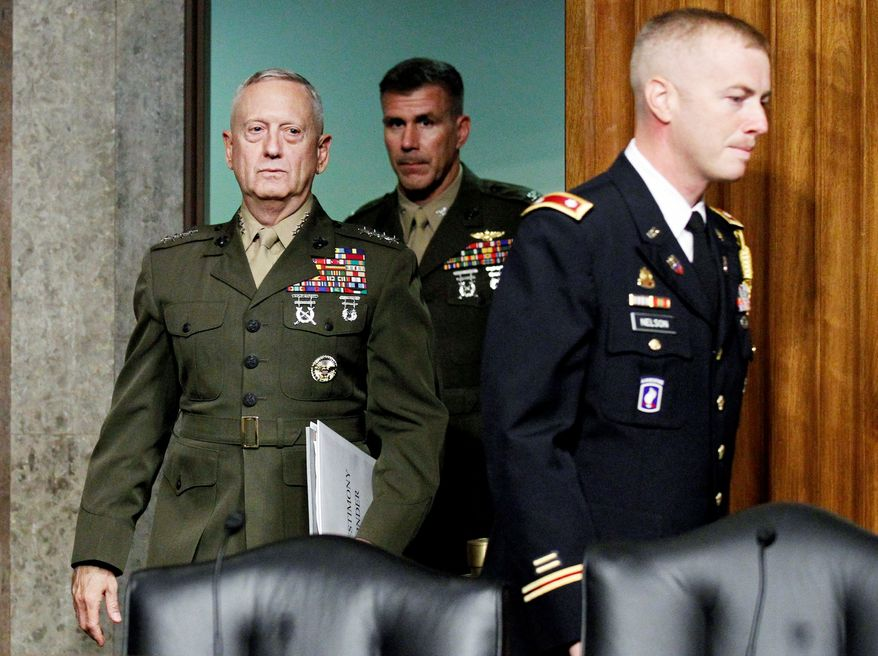 Marine Gen. James Mattis, named to head U.S. Central Command, arrives Tuesday on Capitol Hill to testify at a Senate Armed Services Committee hearing on his nomination. (Associated Press)