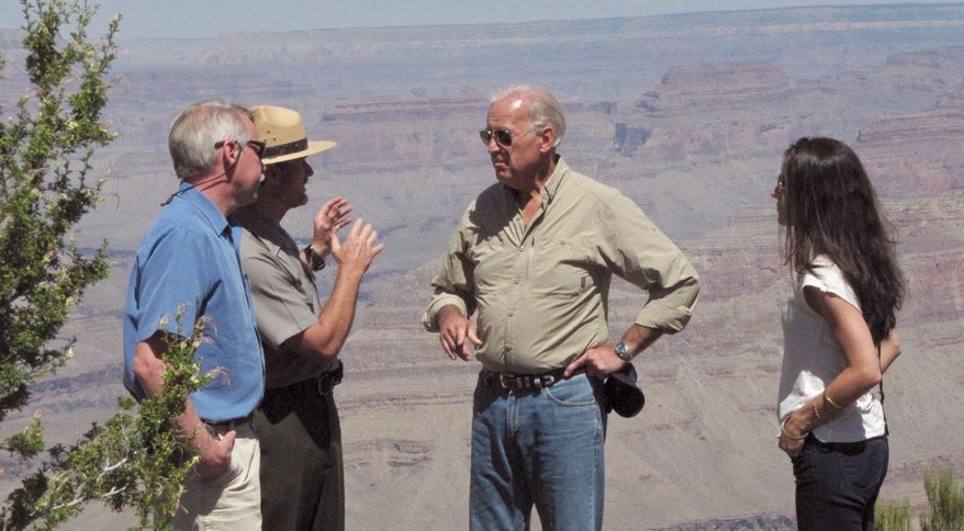 Vice President Joseph R. Biden Jr. speaks with National Park Service Director Jon Jarvis (left), and Grand Canyon National Park Superintendent Steve Martin (in hat) at the Grand Canyon in Arizona. Mr. Biden's daughter, Ashley, also was on hand. (Associated Press)