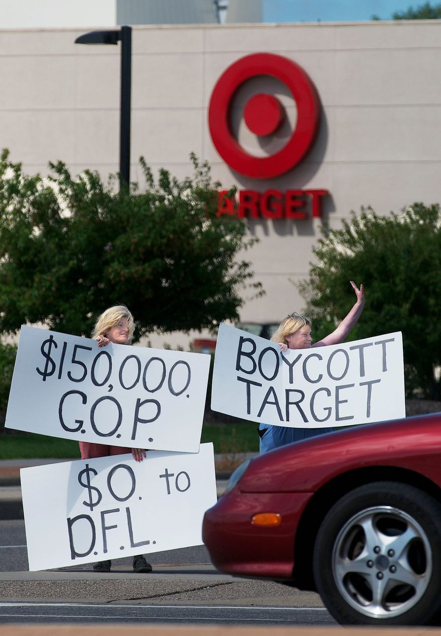 Laura Hedlund (right) and Sue Skog protest in front of Target in Bloomington, Minn., on Saturday after the company donated $150,000 to a group backing the Republican candidate in the governor's race Target Corp.'s CEO Gregg Steinhafel defended the donations. (Associated Press)