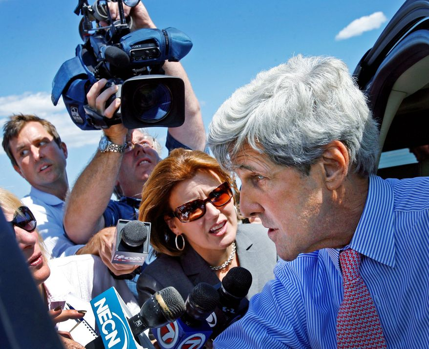 """Mr. Kerry speaks to reporters in Weymouth, Mass. He issued a statement saying he plans to pay """"the equivalent taxes as if the boat's home-port were currently in Massachusetts."""" (Associated Press)"""