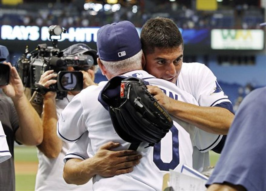 Tampa Bay Rays starting pitcher Matt Garza, right, is congratulated by manager Joe Maddon after Garza threw a no-hitter in a baseball game against the Detroit Tigers on Monday, July 26, 2010, in St. Petersburg, Fla. (AP Photo/Mike Carlson)