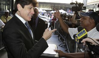 Former Illinois Gov. Rod Blagojevich talks with Darrell Murphy as he arrives at federal court for closing arguments in his federal corruption trial on Tuesday, July 27, 2010, in Chicago. (AP Photo/Charles Rex Arbogast)