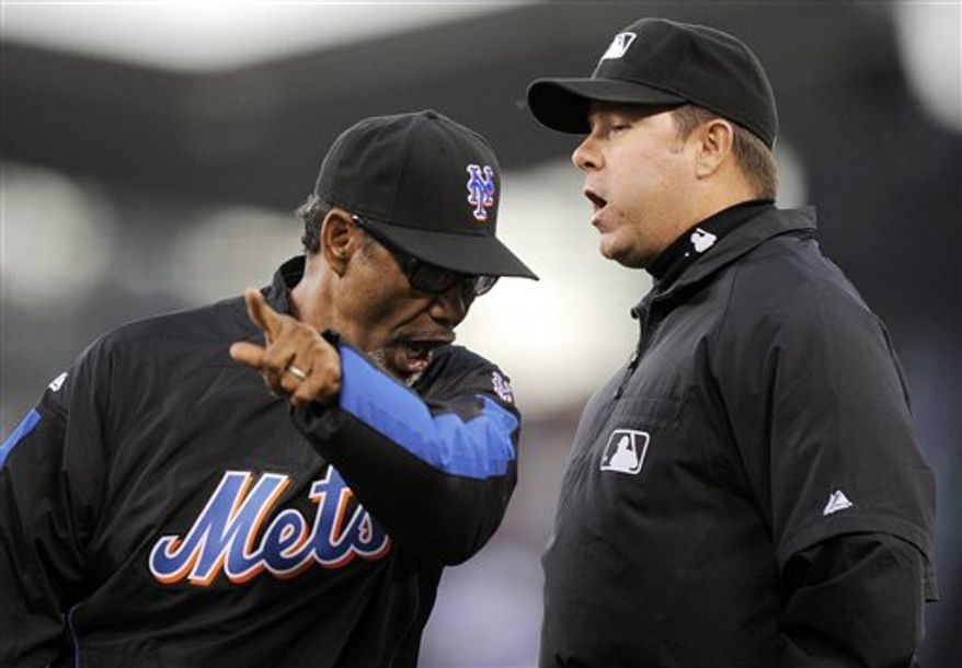 New York Mets manager Jerry Manuel, left, yells at first base umpire Doug Eddings after being thrown out of the game for arguing a call at first during the second inning of their baseball game, Friday, July 23, 2010, in Los Angeles. (AP Photo/Mark J. Terrill)