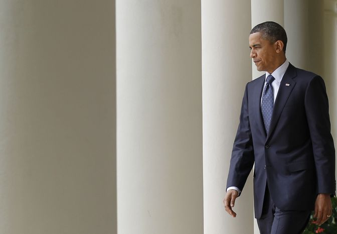 President Obama walks from the Oval Office to the Rose Garden of the White House in Washington on Tuesday, July 27, 2010, to deliver remarks. (AP Photo/Pablo Martinez Monsivais)