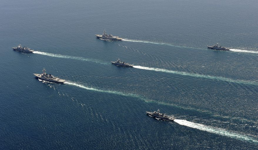 South Korean and U.S. warships participate in joint military drills in the East Sea/Sea of Japan off the Korean peninsula on Tuesday, July 27, 2010. The ships fired artillery and dropped anti-submarine bombs off South Korea's east coast Tuesday, the third day of high-profile military maneuvers intended to warn North Korea against any aggression. (AP Photo/Korean Navy via Yonhap)