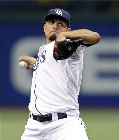 Tampa Bay Rays starting pitcher Matt Garza raises his arms as third baseman Evan Longoria joins him to celebrate Garza's no-hitter in the Rays' 5-0 win over the Detroit Tigers in a baseball game Monday, July 26, 2010, in St. Petersburg, Fla. (AP Photo/Mike Carlson)