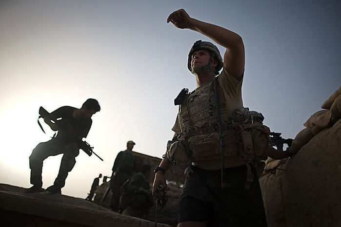 US Army 2LT John Keller, of Downingtown, PA, from 1-320th Alpha Battery, 2nd Brigade of the 101st Airborne Division, directs mortar fire towards insurgent positions during clashes at COP Nolen, in the volatile Arghandab Valley, Kandahar, Afghanistan, Tuesday, July 27, 2010. (AP Photo/Rodrigo Abd)