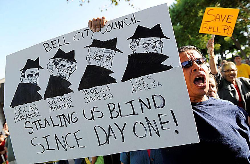 ** FILE ** Bell, Calif., resident Byron Vides holds up a sign as he waits to enter a City Council meeting addressing city leaders' pay on Monday, July 26, 2010, in Bell, Calif. (AP Photo/Chris Pizzello)