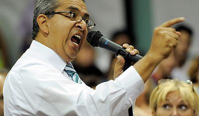 ** FILE ** Bell, Calif., resident Marcelino Ceja yells at City Council members during a meeting addressing city leaders' pay on Monday, July 26, 2010, in Bell, Calif. (AP Photo/Chris Pizzello)