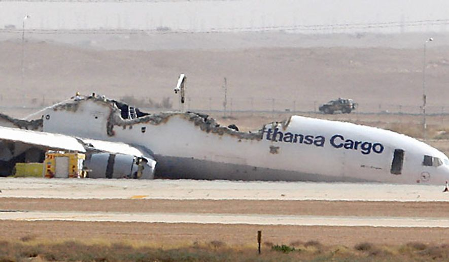 The wreckage of a Lufthansa cargo plane that caught fire and split in half as it was landing lies on the tarmac in the Saudi Arabian capital of Riyadh on Tuesday, July 27, 2010. The German pilot and co-pilot of Flight 8460, which was carrying about 90 tons of unspecified cargo, were slightly injured, an airport official said. (AP Photo)