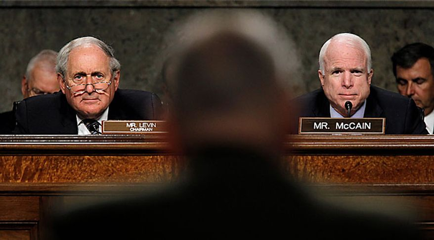 Senate Armed Services Committee Chairman Sen. Carl Levin, D-Mich., left and the committee's ranking Republican Sen. John McCain, R-Ariz., right, question Marine Corps Gen. James Mattis, center, on Capitol Hill in Washington, Tuesday, July 27, 2010, during the committee's hearing on Mattis' nomination to head the U.S. Central Command. (AP Photo/Alex Brandon)
