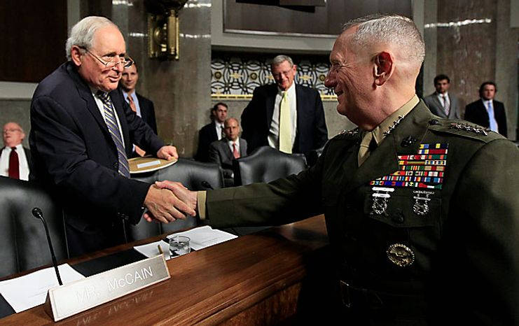 U.S. Central Command Commander-nominee Marine Corps Gen. James Mattis , right, is greeted on Capitol Hill in Washington, Tuesday, July 27, 2010, by Senate Armed Services Committee Sen. Carl Levin, D-Mich., prior to testifying before the committee's hearing on his nomination. (AP Photo/Alex Brandon)