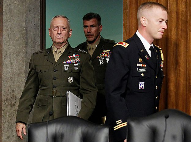U.S. Central Command Commander-nominee Marine Corps Gen. James Mattis, left, arrives on Capitol Hill in Washington, Tuesday, July 27, 2010, to testify before the Senate Armed Services Committee hearing on his nomination. (AP Photo/Alex Brandon)