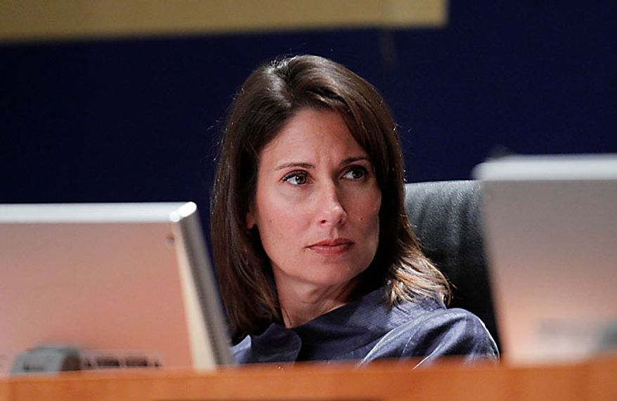 National Transportation Safety Board (NTSB) Chair Deborah Hersman presides at a meeting on the investigation findings and safety issues of the June 22, 2009 collision of two Washington Metrorail trains, Tuesday, July 27, 2010, at the NTSB in Washington. (AP Photo/Charles Dharapak)