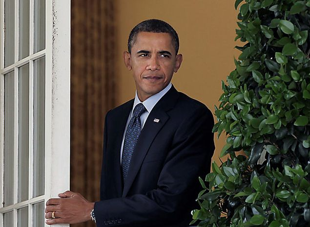 President Barack Obama steps out of the Oval Office of the White House in Washington, Tuesday, July 27, 2010, to make an appeal for bipartisanship on his legislative agenda, in the Rose Garden. (AP Photo/J. Scott Applewhite)