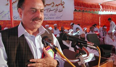 **FILE** Retired Gen. Hamid Gul, former Chief Inter Services Intelligence, addresses students of a Dar-ul-Alumi-Islami, Islamic religious school during a graduation ceremony in Peshawar, Pakistan on Sept. 30, 2001. (Associated Press)