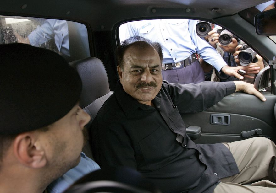 **FILE** Police detains Hamid Gul, former chief of the country's main intelligence agency and a staunch critic of Musharraf's support of the U.S.-led war on terror, in Islamabad, Pakistan on Nov 4, 2007. Authorities rounded up opposition leaders after Gen. Pervez Musharraf suspended Pakistan's constitution, declaring rising Islamic extremism forced him to take emergency measures that included replacing the nation's chief judge and blacking out the independent media that refused to support him. (Associated Press)