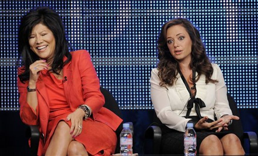 """Julie Chen, left, and Leah Remini, two of the hosts of the new CBS show """"The Talk,"""" participate in a panel discussion at the CBS, Showtime and The CW Television Critics Association summer press tour in Beverly Hills, Calif., Wednesday, July 28, 2010. (AP Photo/Chris Pizzello)"""
