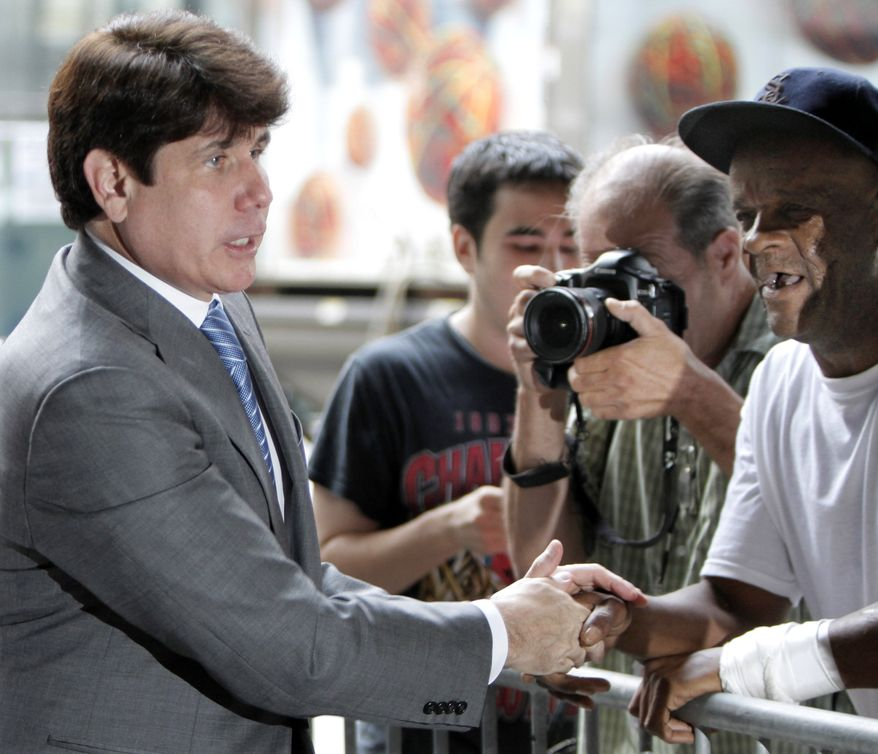 Former Illinois Gov. Rod Blagojevich shakes hands with supporters as he arrives at federal court in Chicago on Wednesday, July 28, 2010, for the beginning of jury instructions in his corruption trial. Mr. Blagojevich and his brother are accused of scheming to sell or trade President Obama's old Senate seat. (AP Photo/M. Spencer Green)