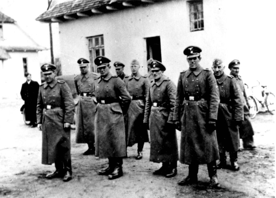 Nazi guards pose at the Belzec death camp in occupied Poland in 1942. Samuel Kunz, 90, has been charged in the murder of 430,000 Jews at the Belzec camp, where he served as a guard from January 1942 to July 1943. (AP Photo/Yad Vashem Photo Archive)