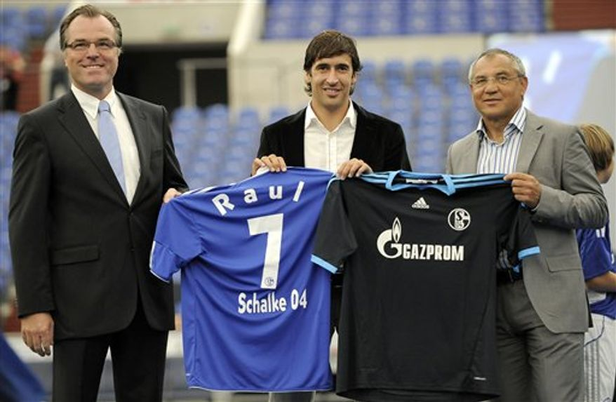 Spanish soccer icon Raul, center, walks with young players at the presentation by his new club FC Schalke 04 at the Veltins-Arena in Gelsenkirchen, Germany, Wednesday, July 28, 2010. The former national team captain of Spain joins FC Schalke 04 with a two-year contract after playing 15 seasons for Real Madrid. (AP Photo/Martin Meissner)