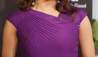 FILE - In this June 30, 2010 file photo, US actress Eva Longoria poses during the presentation of a new refrigerator in Madrid. (AP Photo/Angel Navarrete, file)