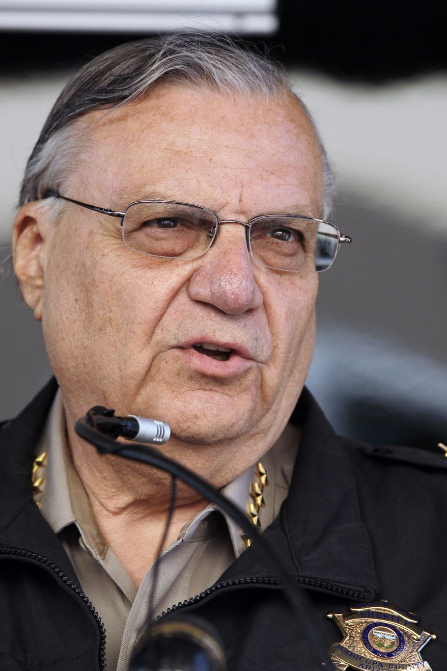 In this April 29, 2010, file photo, Maricopa County, Ariz., Sheriff Joe Arpaio speaks during a press conference, in Phoenix. Without the benefit of their state's strict new immigration law, Arizona officers from Maricopa County helped deport more than 26,000 immigrants from the U.S. through a federal-local partnership that has been roundly criticized as fraught with problems. (AP Photo/Ross D. Franklin, File)