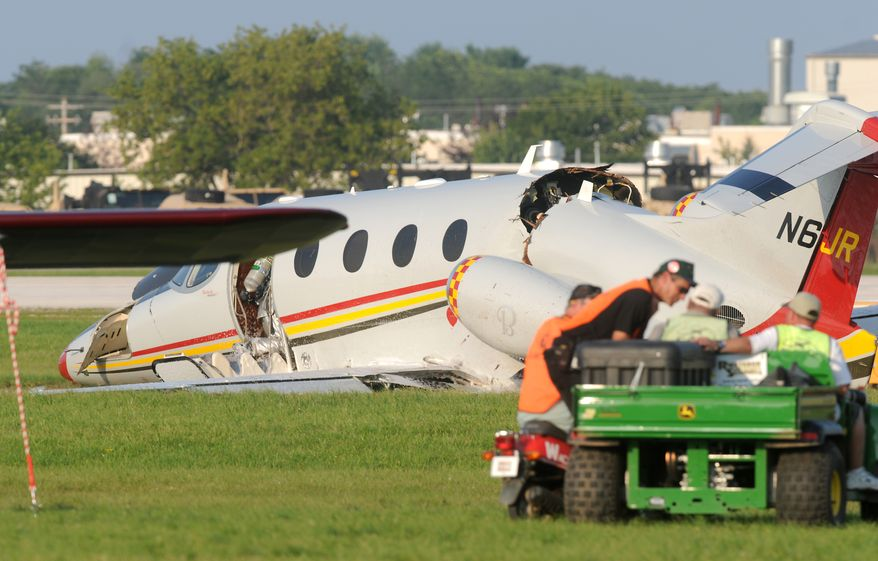 A business jet damaged in a landing lies at Wittman Regional Airport on Tuesday, July 27, 2010, in Oshkosh, Wis. NASCAR team owner Jack Roush was in series but stable condition after walking away from the crash. (AP Photo/Oshkosh Northwestern, Anthony Wahl)