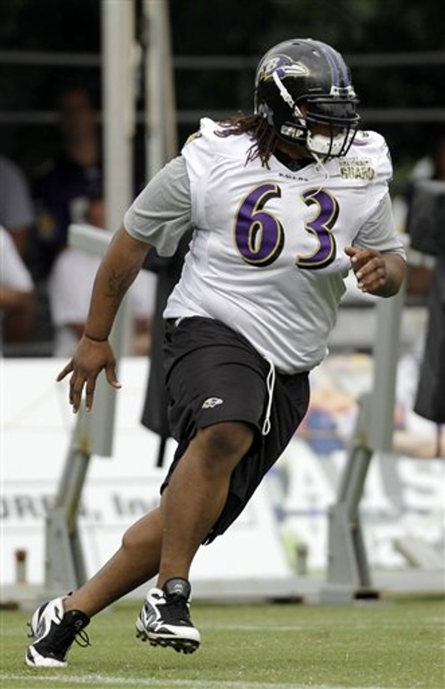 Baltimore Ravens wide receiver Donte' Stallworth catches a pass drills during at the NFL football team's training camp, Friday, July 30, 2010, in Westminster, Md. (AP Photo/Rob Carr)