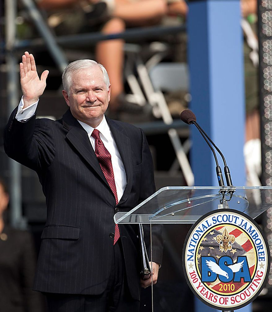 In this photo provided by the Boy Scouts of America, Defense Secretary Robert Gates waves after his speech opening the arena show at the 2010 National Scout Jamboree, Wednesday, July 28, 2010, at Fort A.P. Hill, Va. (AP Photo/HO, Daniel Giles, Boy Scouts of America)