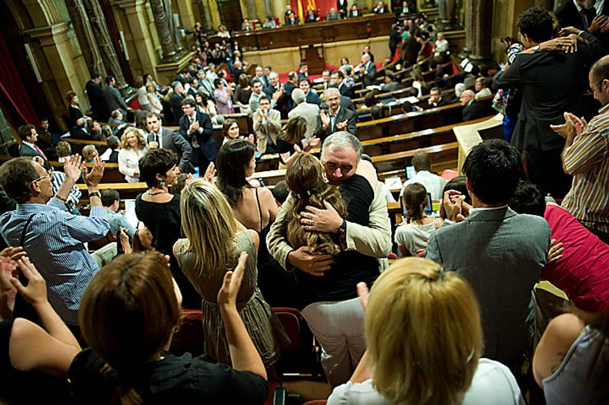 People and politicians celebrate after passing the law to abolish bullfighting in Catalonia, at the Catalan Parliament in Barcelona, Spain, Wednesday, July 28, 2010. (AP Photo/David Ramos)