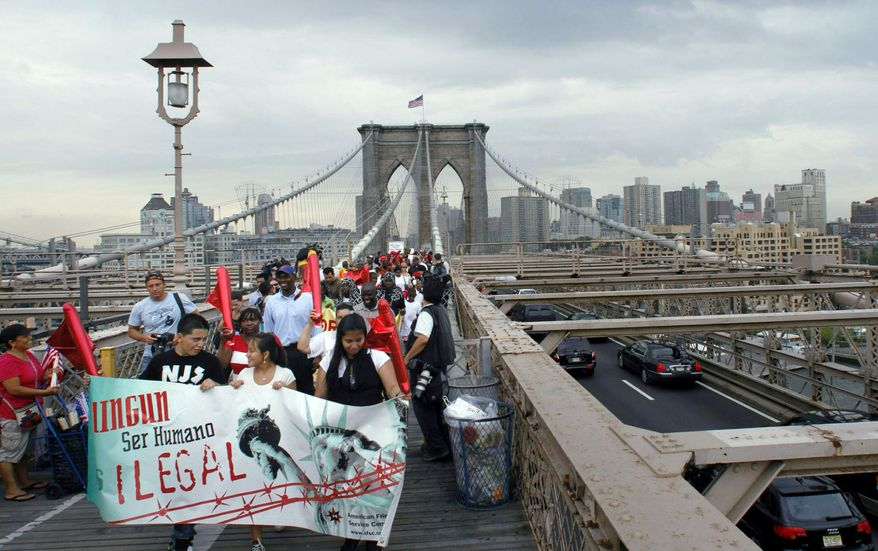 Associated Press PROTEST PARADE: Immigrant rights advocates march across the Brooklyn Bridge in New York to demand full repeal of Arizona's new illegals law. The Obama administration is considering a backdoor approach to stop many deportations.