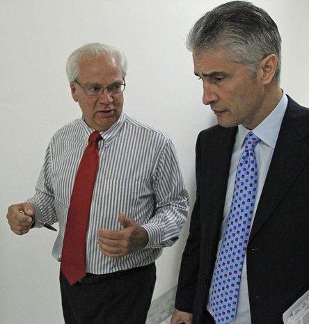 In this photo taken June 16, 2010, John Kausner of Clarence Center, N.Y., left, who's 24-year-old daughter Ellyce died in the crash of Continental Connection Flight 3407 in Feb. 2009, talks to Jeffrey Smisek, right, Continental Airlines President and CEO, to request his support for new airline safety provisions outside a congressional committee hearing on Capitol Hill in Washington. Congress is on the verge of passing far-reaching airline safety legislation, and a lot of the credit goes to the families and friends of the 50 people died in the Flight 3407 crash more than a year ago. (AP Photo/Haraz N. Ghanbari)