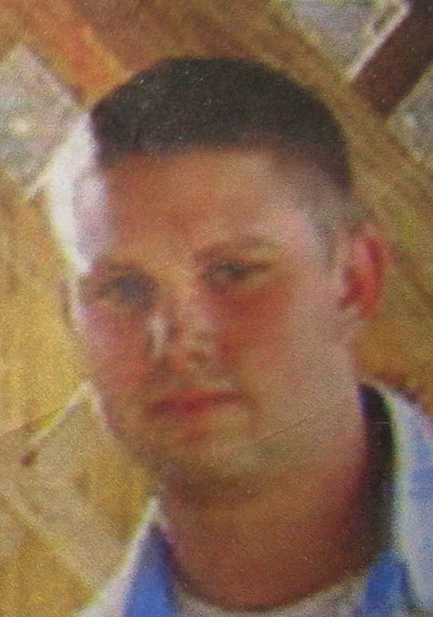 ** FILE ** This photo, displayed on a leaflet that was distributed by the U.S. military to civilians in Logar province, east of Kabul, Afghanistan, on July 25, 2010, shows a missing U.S. Navy sailor, whom the Navy identified as Petty Officer 3rd Class Jarod Newlove, a 25-year-old from the Seattle area. (AP Photo)