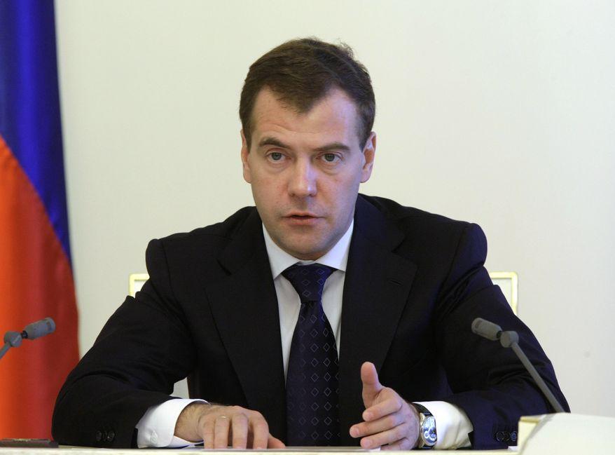 Russian President Dmitry Medvedev speaks to the Cabinet at a meeting, in Moscow's Kremlin, Tuesday, June 29, 2010. (AP photo/RIA Novosti, Vladimir Rodionov, Presidential Press Service)