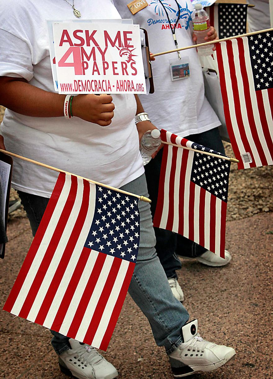 Protesters gather Thursday, July 29, 2010 in Phoenix to rally against Arizona's new immigration law, SB1070. Opponents of Arizona's immigration crackdown went ahead with protests Thursday despite a judge's ruling that delayed enforcement of most the law. (AP Photo/Matt York)