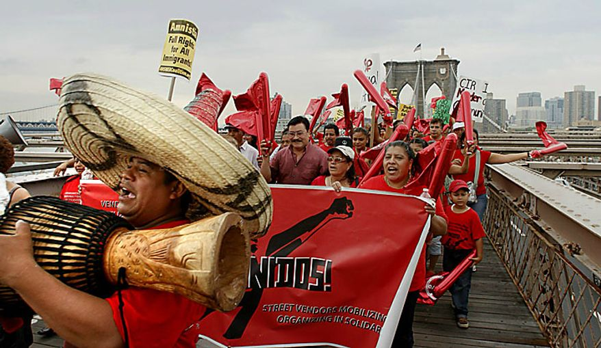 A coalition of immigrant groups and their supporters march across the Brooklyn Bridge, Thursday July 29, 2010, in New York. Protesters are calling for the full repeal of Arizona's immigration law, saying it fuels a climate of racism. (AP Photo/Bebeto Matthews)