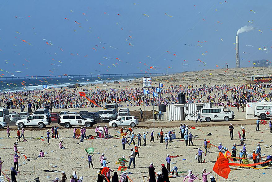 Thousands of Palestinian children fly kites along the beach during a U.N.-sponsored summer camp in the northern Gaza Strip on Thursday, July 29, 2010. The children claimed a world record, flying thousands of kites at the same time. About 8,000 children attended in the event, Khalil el-Halabi, education program head at the U.N. Relief and Works Agency, said.  UPI/Ismael Mohamad.