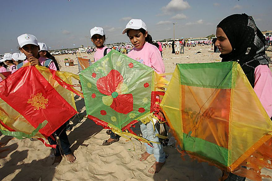 Thousands of Palestinian children in Beit Lahiya, Gaza Strip, fly kites in an attempt to break the world record for the number of kites flying simultaneously. More than 7,200 kites were raised into the air on Thursday, July 29, 2010, setting a new world record in an event sponsored by the United Nations. About 8,000 children attended in the event, Khalil el-Halabi, education program head at the U.N. Relief and Works Agency, said. (UPI/Ismael Mohamad)