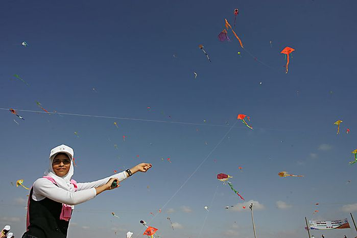 Thousands of Palestinian children fly kites along the beach during a UN-sponsored summer camp in the northern Gaza  on, July 29, 2010. Palestinian children in the impoverished Gaza claimed a world record, flying hundreds of kites at the same time on a northern beach of Gaza. 8,000 children attend in the event, Khalil el-Halabi, education program head at the United Nations Relief and Works Agency (UNRWA) said.  UPI/Ismael Mohamad.