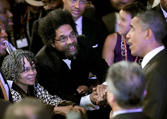 President Obama (right) shakes hands with Princeton University Professor Cornel West (center) and poet Sonia Sanchez (left) after delivering remarks at the National Urban League's 100th anniversary convention in Washington on Thursday, July 29, 2010. (AP Photo/Pablo Martinez Monsivais) ** FILE **
