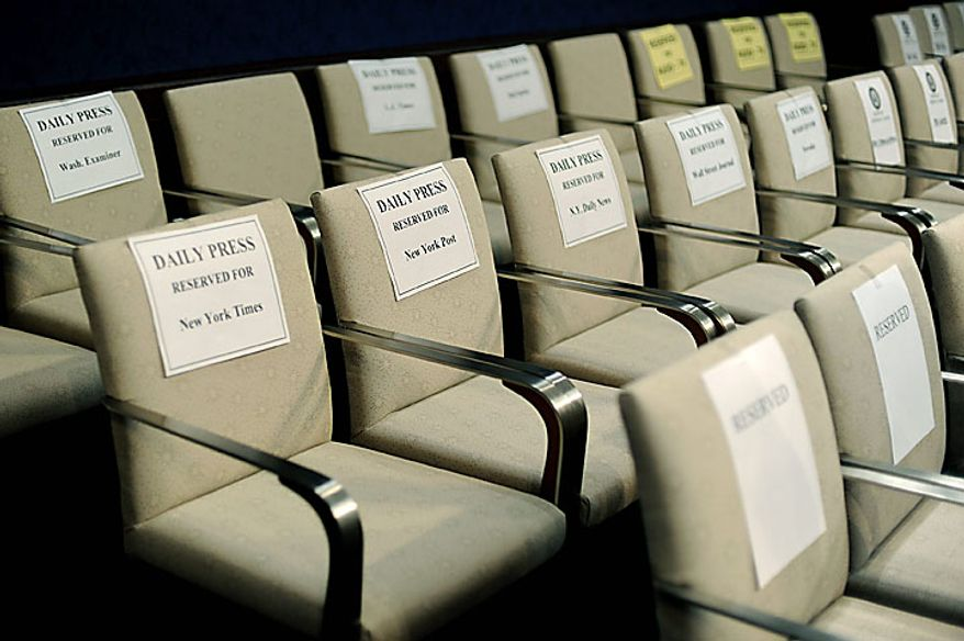 """Chairs reserved for various news outlets, including a row for New York City newspapers, is seen prior to a House Ethics Committee's hearing on the ethical charges brought up against Rep. Charlie Rangel (D-NY), in Washington on July 29, 2010. Rangel's allegations include failure to pay taxes, misuse of rental property and acceptance of """"dirty"""" campaign contributions, among other accusations.  UPI/Kevin Dietsch"""