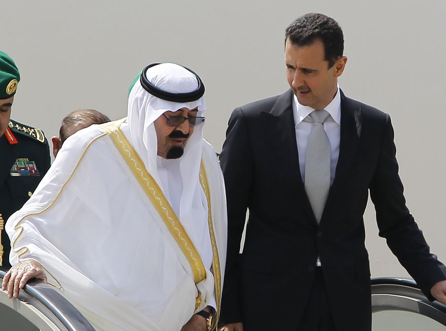Saudi King Abdullah, left, and Syrian President Bashar Assad, right, talk to each other as they step off the plane upon their arrival at Rafik Hariri international airport, in Beirut, Lebanon, on Friday, July 30, 2010. (AP Photo/Hussein Malla)