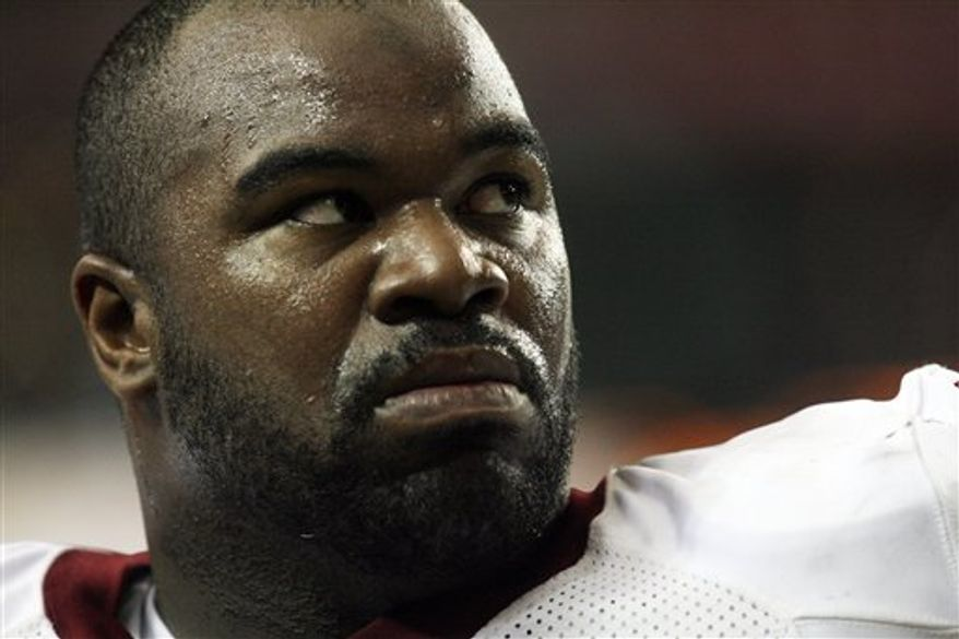 FILE - In this Aug. 21, 2010, file photo, Washington Redskins defensive lineman Albert Haynesworth watches warm ups before an NFL preseason football game against Baltimore Ravens in Landover, Md.  Washington Redskins defensive tackle Albert Haynesworth has been formally charged with misdemeanor assault stemming from a road rage incident earlier this month.  (AP Photo/Susan Walsh, File)