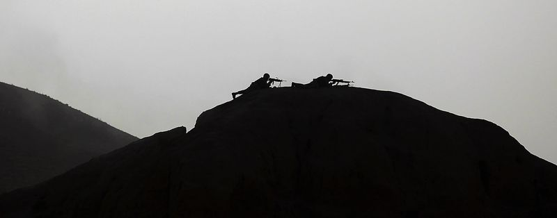 In this July 23, 2010, file photo, United States Marines from Bravo Company of the 1st Battalion of the 2nd Marines fire machine guns for suppression during a gunbattle as part of an operation to clear the area of insurgents near Musa Qaleh, in northern Helmand Province, southern Afghanistan. (AP Photo/Kevin Frayer, File)